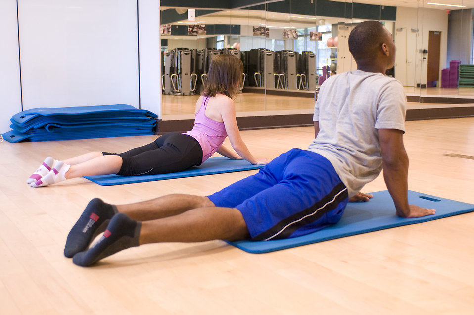 a-man-and-woman-working-out-in-a-fitness-center-pv